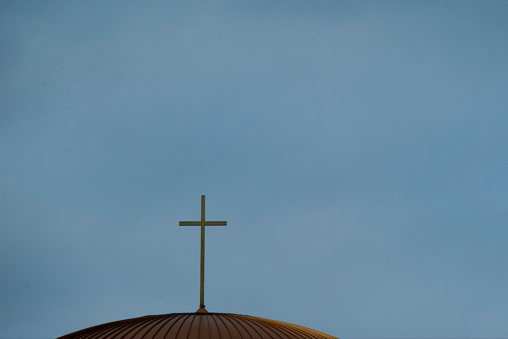A cross sits atop St Ann Catholic Parish in Coppell, Texas on October 12, 2014. (Cooper Neill for The New York Times)