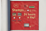 A Post office stamp-machine making stamps available 24 hours a day outside their branch at Stamford Hill, London.