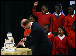 The Earl of Wessex Prince Edward cuts his birthday cake on his 50th Birthday as The Earl and Countess of Wessex, Founders of the Wessex Youth Trust, visit The Robert Browning Primary School, Walworth, London, United Kingdom, to see the work of youth charity Kidscape, Monday, 10th March 2014. Picture by Andrew Parsons / i-Images