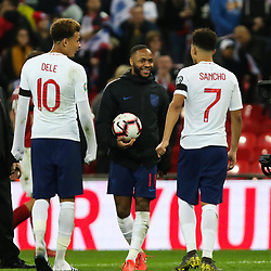 Raheem Sterling of England with the match ball at the final whistle