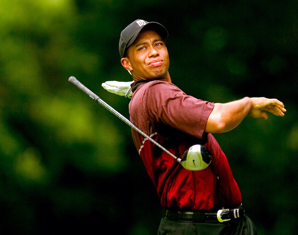 Tiger Woods lets go of his club after a bad tee shot on the sixth hole at Cog Hill GC in Lemont, Illinois during the final round of the 2003 Western Open.