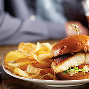 grouper sandwich with chips and craft beer