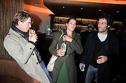 Left to right, SCOTT DOUGLAS, TRACEY EMIN and BARRY REIGATE at a reception following the screening of the film '44 Inch Chest' part of the 2009 BFI London Film Festival, held at Maddox, 3-5 Mill Street, London on 17th October 2009.