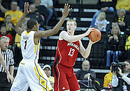 January 26, 2012: Nebraska Cornhuskers forward Brandon Ubel (13) looks to pass around Iowa Hawkeyes forward Melsahn Basabe (1) during the NCAA basketball game between the Nebraska Cornhuskers and the Iowa Hawkeyes at Carver-Hawkeye Arena in Iowa City, Iowa on Thursday, January 26, 2012.