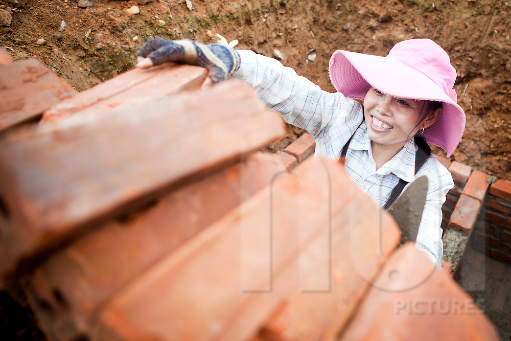 Bricklayer working on a construction site, Lao Cai Province, Vietnam, Southeast Asia