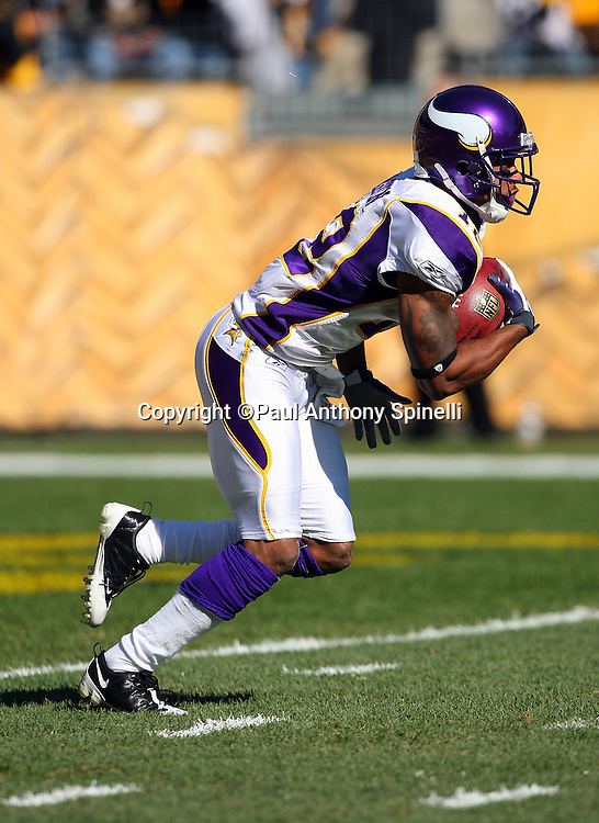 Minnesota Vikings kick returner Percy Harvin (12) returns a kickoff during the NFL football game against the Pittsburgh Steelers, October 25, 2009 in Pittsburgh, Pennsylvania. The Steelers won the game 27-17. (©Paul Anthony Spinelli)