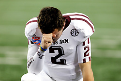 Texas A&M Quarterback Johnny Manziel (2) prays before the start of the 77th AT&T Cotton Bowl Classic between the Texas A&M University Aggies and the Oklahoma University Sooners at Cowboys Stadium in Arlington, Texas. Texas A&M wins the 77th AT&T Cotton Bowl Classic against Oklahoma, 41-13.