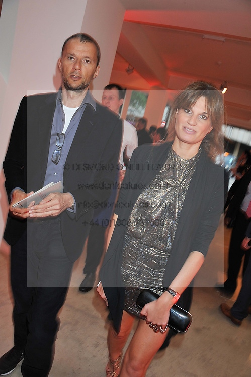 JEMIMA KHAN and JOHN BATTSEK at a dinner in aid The Journalism Foundation held at Philips De Pury & Company, Howick Place, London, SW1 on 22nd May 2012.