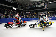 Mark Cheza (16) of Clio, Michigan glances back at Darren Carter (43) of Bloomington, Illinois during a Manufacturers World Cup Bikes heat at the 35th Annual World Championship ICE Racing Series held at the Cedar Rapids Ice Arena at 1100 Rockford Road SW in Cedar Rapids on Saturday evening January 15, 2011.