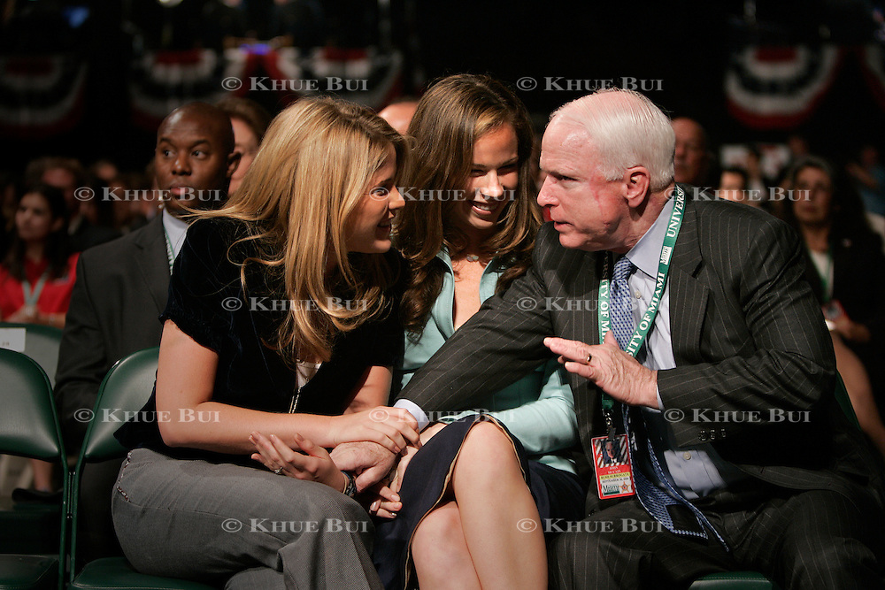 Jenna and Barbara Bush talk with Sen. John McCain (R-AZ) prior to the first of three presidential debates Thursday, September 30, 2004, in Miami, FL...Photo by Khue Bui
