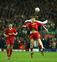 LIVERPOOL, ENGLAND - Tuesday, March 19, 2002: Liverpool's John Arne Riise and AS Roma's Francisco Govinho Lima during the UEFA Champions League Group B match at Anfield. (Pic by David Rawcliffe/Propaganda)