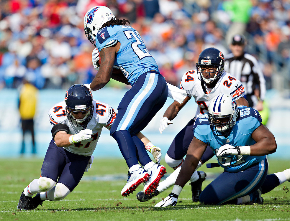 NASHVILLE, TN - NOVEMBER 4:  Chris Johnson #28 of the Tennessee Titans is tackled by Chris Conte #47 of the Chicago Bears at LP Field on November 4, 2012 in Nashville, Tennessee.  The Bears defeated the Titans 51-20.  (Photo by Wesley Hitt/Getty Images) *** Local Caption *** Chris Johnson; Chris Conte