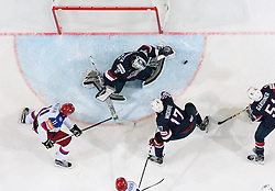 Yevgeni Malkin of Russia vs Connor Hellebuyck of USA, John Moore jr. of USA and Jake Gardiner of USA during Ice Hockey match between USA and Russia at Semifinals of 2015 IIHF World Championship, on May 16, 2015 in O2 Arena, Prague, Czech Republic. Photo by Vid Ponikvar / Sportida