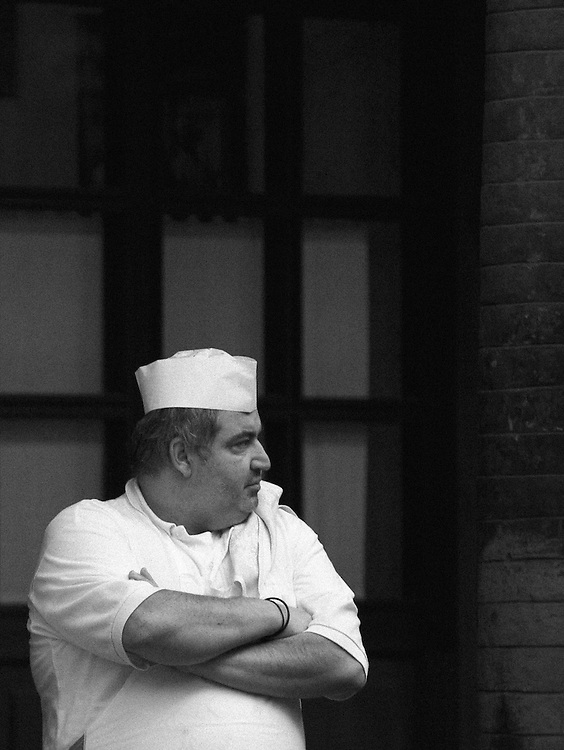 Black and white photography of a chef in Bologna Italy.