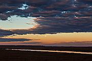 Sunrise over the Edisto River and marsh as the moon sets in Edisto Island, South Carolina.
