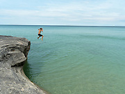 "A boy jumps into Lake Superior..  Image from the area known as ""The Cove,"" Pictured Rocks National Lakeshore, Michigan, USA."