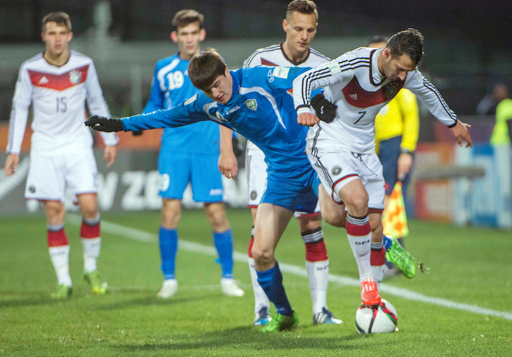 Javokhir Sokhibov of Uzbekistan, left, contests for the ball with Levin Oeztunali of Germany in the Under 20 soccer World Cup match, Christchurch, New Zealand, Thursday, June 04, 2015. Credit:SNPA / David Alexander
