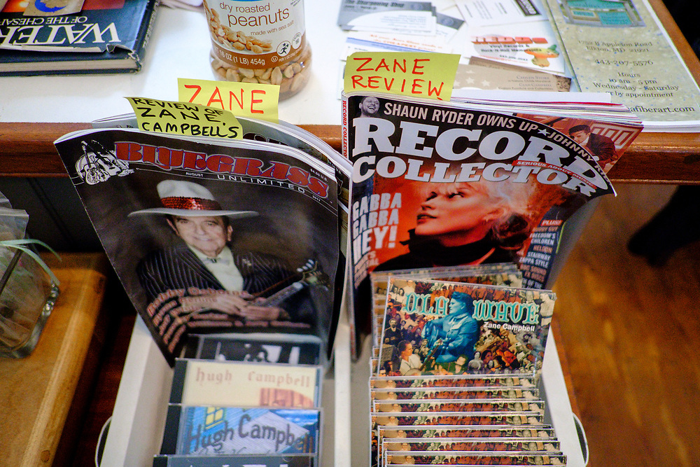CHILDS, MARYLAND - SEPTEMBER 2: Magazines with stories and review of Zane Campbell's music is on display in the Childs Store on Saturday, September 2, 2017 in Childs, Maryland. Most Campbells are store owners and artists and musicians, including his Aunt Ola Belle, a star of old-time/bluegrass music in the 60s and 70s, who also ran a country-music park. (Photo by Pete Marovich For The Washington Post)
