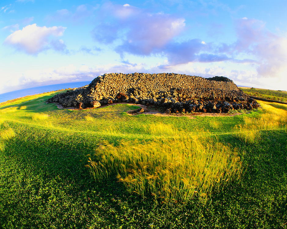 0860-1003C ~ Copyright: George H.H. Huey ~ Mo'okini Heiau [37 feet by 267 feet], a luakini heiau, or human sacrifice temple, at sunset, with the Alenuihaha Channel in distance.  Oral tradition dates this heiau to 480 A.D.  North Kohala district, the Big Island, Hawaii.