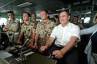 """25 SEP 2006, GOLF VON TADJURA/DJIBOUTI:<br /> Franz Josef Jung (R), CDU, Bundesverteidigungsminister, am Ruder, auf der Bruecke der Fregatte """"Schleswig-Holstein"""", die als Flaggschiff Teil des deutschen Marinekontingents der OPERATION ENDURING FREEDOM ist und im Seegebiet am Horn von Afrika operiert,  Djibouti<br /> IMAGE: 20060925-01-124<br /> KEYWORDS: Dschibuti, Bundeswehr, Marine, Soldat, Soldaten, Steuer, Afrika, Africa"""
