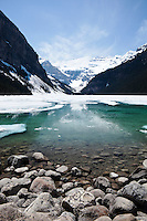 Lake Louise Partially Frozen During Spring Season With Victoria Glacier in the Background, Banff National Park, Alberta, Canada