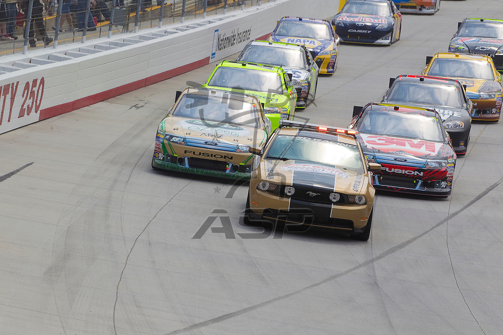 BRISTOL, TN - MAR 20, 2011:  The NASCAR Sprint Cup Series teams take to the track for the Jeff Byrd 500 race at the Bristol Motor Speedway in Bristol, TN.