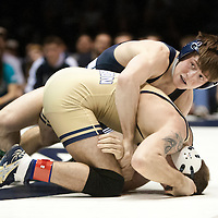 February 23, 2014; State College, PA, USA; Penn State's Jimmy Gulibon works on top of Clarion's Victor LiPari in their 133-pound match at Rec Hall. Gulibon scored a 16-0 technical fall win and Penn State defeated Clarion 43-3.