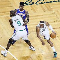 26 April 2013: Boston Celtics small forward Paul Pierce (34) drives past New York Knicks small forward Iman Shumpert (21) on a screen set by Boston Celtics center Kevin Garnett (5) during Game Three of the Eastern Conference Quarterfinals of the 2013 NBA Playoffs at the TD Garden, Boston, Massachusetts, USA.