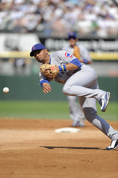 CHICAGO - JUNE 27:  Andres Blanco #13 of the Chicago Cubs makes an off balance throw to first base against the Chicago White Sox on June 27, 2009 at U.S. Cellular Field in Chicago, Illinois.  The White Sox defeated the Cubs 8-7.  (Photo by Ron Vesely)