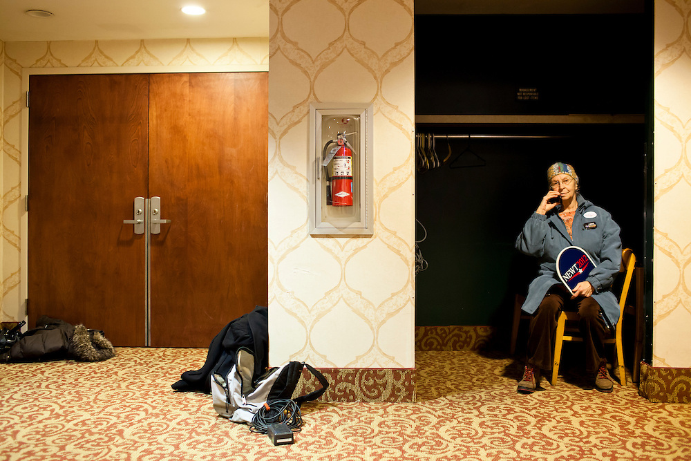 A supporter of Republican presidential candidate Newt Gingrich sits in a closet as the candidate speaks with voters at Junction Sports Bar & Grill on Sunday, January 1, 2012 in Marshalltown, IA.