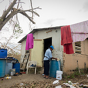 SEPTEMBER 25 - LOIZA, PUERTO RICO - <br /> Fisherman Justino Rodriguez Rivera, 53, washes clothes with water from a well in the coastal area of Pi&ntilde;ones in Loiza which sustained heavy damage by the destructive path of Hurricane Maria. Rodriguez along with his wife evacuated to their church.<br /> (Photo by Angel Valentin for NPR)