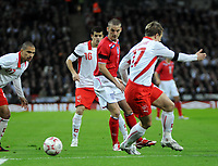 Photo: Tony Oudot/Richard Lane Photography. <br /> England v Switzerland. International Friendly. 06/02/2008.<br /> David Bentley of England is beaten to the ball by Christoph Spycher of Switzerland