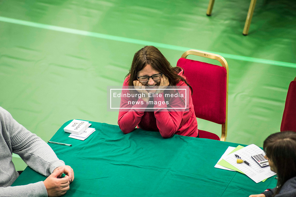 Counting staff relax while waiting for the first ballot boxes.<br /> <br /> © Dave Johnston/ EEm