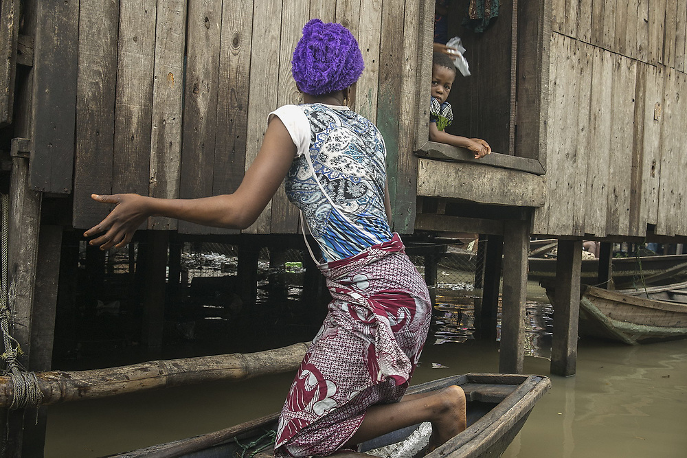 A mother returns home to her daughter in the Makoko slum