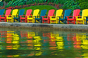 Muskoka chairs reflected in Lake Rosseau<br />