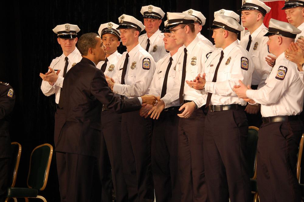 President Obama personally congratulates each of the 25 Columbus Police Academy graduates.