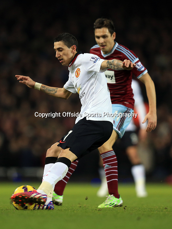 8 February 2015 - Barclays Premier League - West Ham United v Manchester United - Angel Di Maria of Manchester United in action with Stewart Downing of West Ham - Photo: Marc Atkins / Offside.