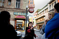 """At this intersection of Commercial and Grants streets, marks the original shoreline, in the mid-1958s, of the Barbary Coast, where sailers would stop of for opium-laced whiskey, and women, in Chinatown. The term, """"shanghi-ed"""" was coined since then as sailors found themselves on a merchant ship, bound for Asia. Cynthia Yee leads a feng shui tour of Chinatown, stopping at various sites in Chinatown explaining its history and use of feng shui, in San Francisco, Ca., on Friday, June 18, 2010."""