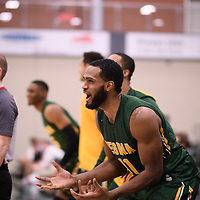 5th year forward Brian Ofori (11) of the Regina Cougars during the Men's Basketball home game on November 11 at Centre for Kinesiology, Health and Sport. Credit: Arthur Ward/Arthur Images