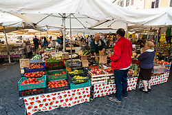 Traditional daily farmers market on Campo de Fiori square in Rome , Italy