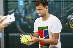 April 23, 2018 - Barcelona, Spain - BARCELONA, SPAIN - APRIL 23: Grigor Dimitrov from Bulgaria signing autographs to the young fans during the Barcelona Open Banc Sabadell 66º Trofeo Conde de Godo at Reial Club Tenis Barcelona on 23 of April of 2018 in Barcelona. (Credit Image: © Xavier Bonilla/NurPhoto via ZUMA Press)