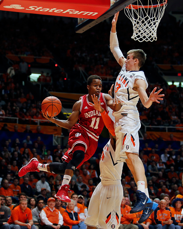 Indiana guard Kevin Yogi Ferrell (11) gets pressure under the rim from Illinois forward Jon Ekey (33) and guard Rayvonte Rice (24) during the first half of an NCAA college basketball game at the State Farm Center Tuesday, Dec. 31, 2013, on the University of Illinois campus in Champaign, Ill. Illinois won the Big Ten opener 83-80. (Lee News Service/ Stephen Haas)