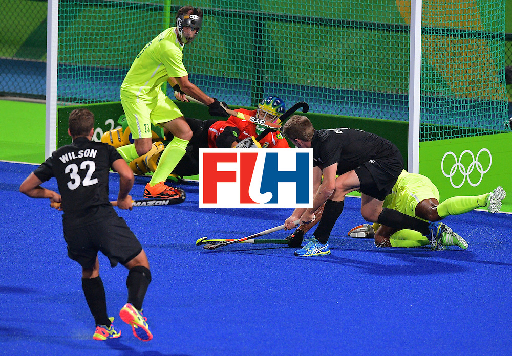New Zealand's Stephen Jenness (R) takes a shot on goal during the men's field hockey New Zealand vs Brazil match of the Rio 2016 Olympics Games at the Olympic Hockey Centre in Rio de Janeiro on August, 10 2016. / AFP / Carl DE SOUZA        (Photo credit should read CARL DE SOUZA/AFP/Getty Images)
