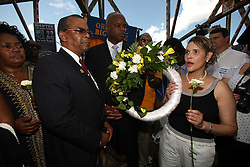 29 August 2007. Lower 9th Ward, New Orleans, Louisiana. <br /> Second anniversary of Hurricane Katrina. Local council woman Cynthia Willard Lewis leads a prayer with ministers at the top of the Claiborne Bridge where wreaths and flowers were thrown into the canal in memory of the victims of Hurricane Katrina. Residents had gathered at the hurricane Katrina memorial in the Lower 9th Ward to remember those who perished when the industrial canal levee breached less than a mile from where they stand. Many residents are struggling to return to the still derelict and decimated Lower 9th Ward.<br /> Photo credit©; Charlie Varley/varleypix.com