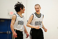 Mount Mansfield's Wyatt Faberge (24) and Ryan Luitjens (2) smile at each other as they head down the court during the unified basketball game between Colchester and Mount Mansfield at MMU High School on Monday afternoon April 25, 2016 in Jericho. (BRIAN JENKINS/for the FREE PRESS)