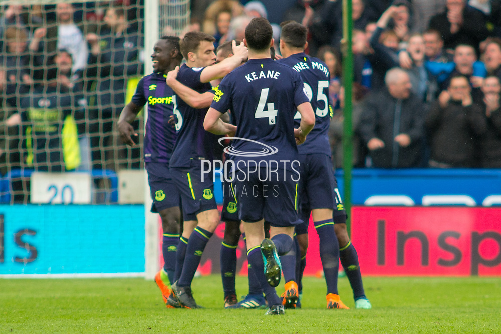 Everton celebrate as Everton midfielder Idrissa Gueye scores a goal to make it 0-2 during the Premier League match between Huddersfield Town and Everton at the John Smiths Stadium, Huddersfield, England on 28 April 2018. Picture by Craig Zadoroznyj.
