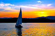Sunset sail on Lake James in Morganton, North Carolina. <br /> <br /> &copy; Photography by Kathy Kmonicek