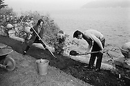 1959. Alain Delon et Romy Schneider Gardening in Lugano, Switzerland.<br /> <br /> 1959. Alain Delon et Romy Schneider faisant du Jardinage &agrave; Lugano, Suisse .