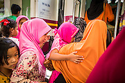 27 OCTOBER 2012 - SUNGAI KOLOK, NARATHIWAT, THAILAND:  Passengers line up to board a northbound train during the holiday of Eid al-Adha in the province of Narathiwat, Thailand. Many Thai Muslims travel during the Eid holiday to go home to family. Trains are a popular form of transportation in rural Thailand. Sungai Kolok has been a center of extremist violence. Several car bombs have been detonated in the city, which is on the Malaysian border and very popular with Malaysian tourists. More than 5,000 people have been killed and over 9,000 hurt in more than 11,000 incidents, or about 3.5 a day, in Thailand's three southernmost provinces and four districts of Songkhla since the insurgent violence erupted in January 2004, according to Deep South Watch, an independent research organization that monitors violence in Thailand's deep south region that borders Malaysia.   PHOTO BY JACK KURTZ