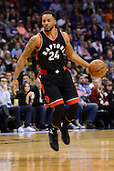 Dec 29, 2016; Phoenix, AZ, USA;  Toronto Raptors guard Norman Powell (24) dribbles the ball up the court in the first half of the NBA game against the Phoenix Suns at Talking Stick Resort Arena. The Suns won 99-91. Mandatory Credit: Jennifer Stewart-USA TODAY Sports